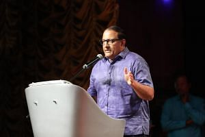 In a photo taken on Sept 15, Minister for Communications and Information S. Iswaran speaks at a book launch.