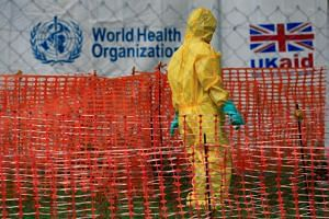 A person dressed in protective apparel is seen inside an Ebola care facility at the Bwera general hospital in Uganda, on June 14, 2019.
