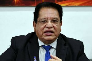 Umno MP Tengku Adnan Tengku Mansor (pictured) was charged with receiving RM1 million from Datuk Tan Eng Boon through a Public Bank cheque deposited into his account.