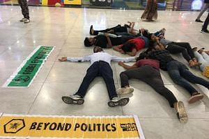 "XR volunteers stage a ""die-in"" at a mall in Chandigarh."