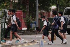 Nanhua Primary School students walking to school at around 7.10am on Sept 19, 2019.