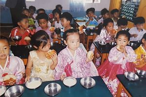 Children in Sariwon in North Korea's North Hwanghae province having bread and soya milk provided by a bakery under non-governmental group Love North Korean Children. At each of the group's six bakeries in the country, local workers produce fresh brea