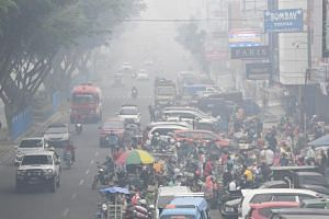 Pekanbaru, the capital of haze-shrouded Riau province, has been blanketed in thick haze originating from neighbouring provinces Jambi and South Sumatra.