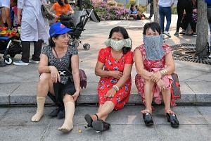 Vietnamese tourists wearing masks in Singapore last week.
