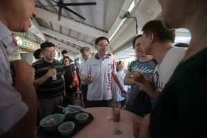 Deputy Prime Minister Heng Swee Keat meeting diners at Tampines Round Market and Food Centre in July. Before the polls, each constituency will unveil its own local manifesto which details plans for the neighbourhood, such as upcoming infrastructure p