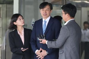 A photo taken on Sept 20 shows South Korean Justice Minister Cho Kuk talking to reporters after a dialogue with a group of prosecutors at a district prosecutors' office in Uijeongbu, South Korea.