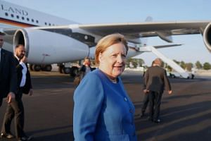 German Chancellor Angela Merkel arrives at John F. Kennedy Airport in New York on Sept 22 to take part in the United Nations climate summit.