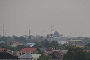 Hazy skies in Banda Aceh, capital of Aceh province, in Sumatra, yesterday. The Indonesian Environment and Forestry Ministry's law enforcement director-general Rasio Ridho Sani told The Straits Times that a few companies affiliated to Singapore and Ma