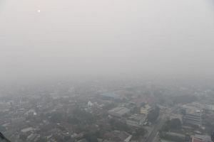 A photo taken on Sept 20 shows Pekanbaru in Indonesia's Riau province shrouded in haze.