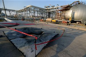 A metal part of a damaged tank is seen at the damaged site of Saudi Aramco oil facility in Abqaiq, Saudi Arabia, on Sept 20, 2019.