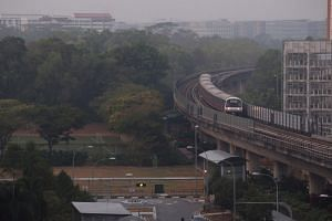 A train returning to Pasir Ris MRT station from Tampines in hazy conditions at 7.14am on Sept 24, 2019. The 24-hr PSI level at 7am was 90 for the eastern part of Singapore and 1-hr PM2.5 reading at 42 (µg/m3).