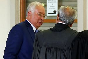 In a  photo taken on Aug 28, former prime minister Najib Razak talks to his lawyer Muhammad Shafee Abdullah during a break at Kuala Lumpur High Court in Kuala Lumpur.