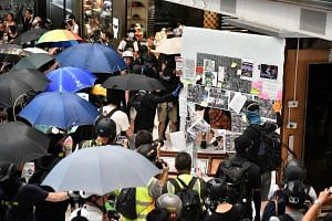 Protesters tearing down the interiors of New Town Plaza in Hong Kong on Sept 22, 2019. Apple Daily reported that the journalist was attacked at a restaurant on Tuesday night by four men dressed in black and wearing the protesters' trademark yellow he