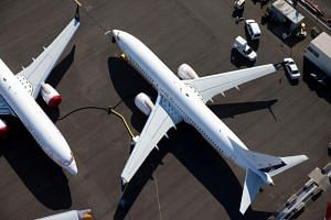 In a file photo from July 1, 2019, a Boeing 737 Max aircraft is seen grounded at a storage area in an aerial photo at Boeing Field in Seattle, Washington.