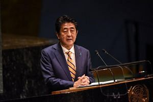 Japanese Prime Minister Shinzo Abe criticised Seoul's decision last month to allow a bilateral military intelligence pact to lapse on Nov 23.