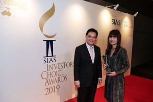Deputy Prime Minister and Finance Minister Heng Swee Keat with The Straits Times' senior correspondent Joyce Lim at the Sias 20th Investors' Choice Awards on Sept 26, where Ms Lim received a Special Award in financial journalism.