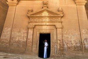 A Saudi tour guide stands inside a tomb at the Madain Saleh antiquities site, al-Ula, Saudi Arabia.