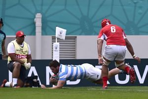 Argentina's Julian Montoya scores their first try during the Rugby World Cup match against Tonga on Sept 28, 2019.