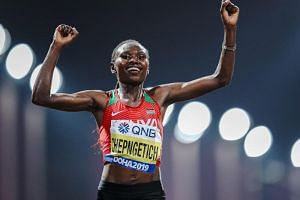 Kenya's Ruth Chepngetich celebrates after winning the women's marathon race during the 2019 IAAF World Athletics Championships in Doha on Sept 28, 2019.