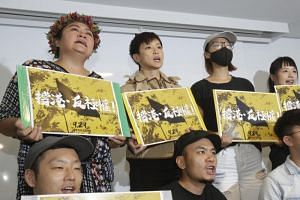 "In a photo taken on Sept 12, Hong Kong singer Denise Ho (centre) shouts slogans calling on Taiwanese people to take part in the ""Hold Hong Kong, anti-totalitarian"" march on Sept 29, during a press event in Taipei."
