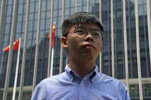 Hong Kong activist Joshua Wong says he will run in district council elections in November.
