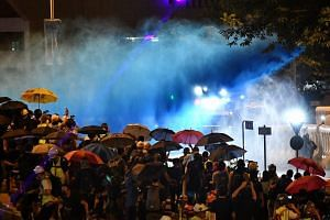 Police spraying blue dye at protesters with their water cannon truck near the Legislative Council building in Hong Kong on Sept 28, 2019.
