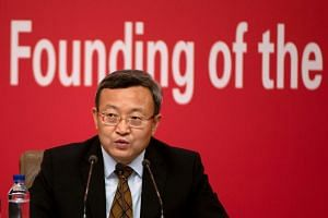 China's Commerce vice-minister Wang Shouwen answers questions during a press conference in Beijing on Sept 29, 2019.