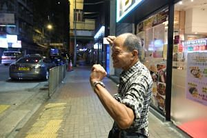 """Mr Lou Tit Man in Mong Kok, Hong Kong on Sept 23, 2019. Known locally as """"Iron Man"""", a play on his Chinese name and reputation for resilience, he spent four months in jail during the 2014 """"Umbrella Movement""""."""