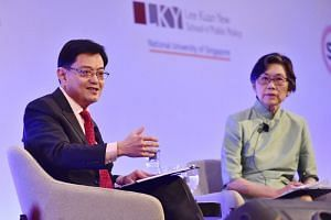 Singapore's Deputy Prime Minister Heng Swee Keat (left) speaking at the Singapore Bicentennial Conference, with Ambassador-at-Large for the Ministry of Foreign Affairs Chan Heng Chee, at the Fairmont Ballroom of the Raffles City Convention Centre on