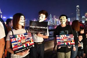 Protesters at the Avenue of Stars, along Hong Kong's Victoria Harbour, on Sept 30, 2019. Malaysian police are investigating a rally in Kuala Lumpur held in support of the Hong Kong protest movement.
