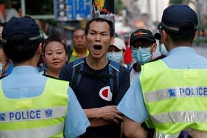 An anti-government protester shouting slogans in front of Wan Chai station in Hong Kong during China's National Day on Oct 1, 2019.