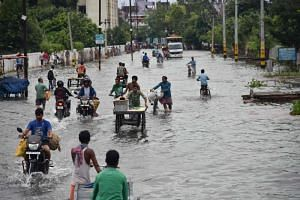 Commuters make their way on a waterlogged road following heavy rainfall in Patna, India, on Sept 30, 2019. The monsoon has already delivered 10 per cent more rain than a 50-year average.