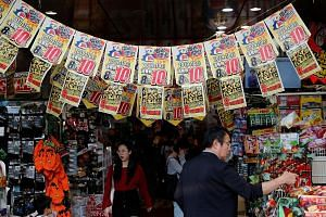 Banners announcing the rise of the national sales tax to 10 per cent in a Tokyo shop. The increase took effect yesterday, raising concerns that the Japanese economy might not withstand the blow. PHOTO: REUTERS