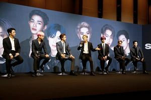Taemin of Shinee speaks as SuperM members attend a news conference in Seoul on Oct 2, 2019.