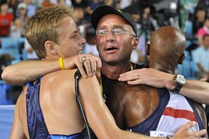 A 2011 photo shows Salazar (centre) hugging Britain's Mo Farah (right) and US athlete Galen Rupp after a race.
