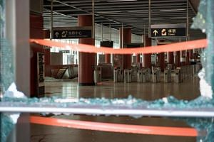 Shattered glass windows and damaged turnstiles at Tseung Kwan O MTR station are seen on Oct 5, 2019, the morning after protesters ransacked the facilities.