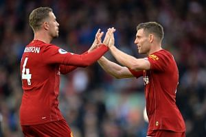 Liverpool captain Jordan Henderson (left) and team mate James Milner celebrate at the end of the match.