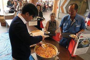 Visitors to the inaugural Singapore Fair, held at the Rikuzentakata Community Hall yesterday, were treated to a lunch that featured Singaporean dishes such as laksa and chicken rice. ST PHOTO: WALTER SIM