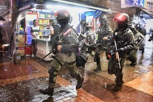 Riot police combing alleys to search for protesters in Mong Kok, Hong Kong, on Oct 6, 2019.