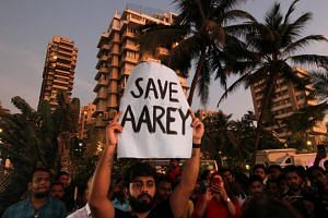 A protest demanding that the Mumbai Metro Rail Corp Ltd not cut trees to build a train parking shed for an upcoming subway line, in Mumbai, on Oct 6, 2019.