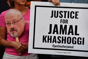 Advocates for journalist Jamal Khashoggi held a candlelight vigil in front of Saudi Arabia's embassy on Oct 2, 2019. PHOTO: THE WASHINGTON POST