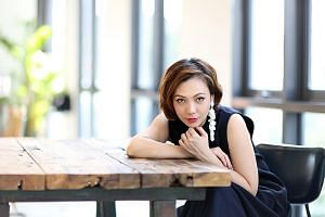 Singer Kit Chan spent a lot of time in the past at Raffles Hotel's former eateries Empire Cafe and Seah Street Deli. She will be singing some classic tunes at the hotel's reopening event on Oct 18. LIANHE ZAOBAO FILE PHOTO