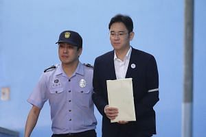 A photo taken on Aug 25, 2017, shows Samsung Group heir Lee Jae-yong leaving the Seoul Central District Court following his verdict.
