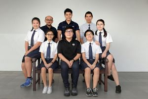 (Clockwise from far left) Dunman High School student Zhang Yiying, Dunman High School teacher Ang Eng Choon, SCDF full-time national serviceman Daniel Wong, Dunman High School alumnus Ken Teo Rong Jye, Dunman High School student Liau Xuan Xuan Valeri