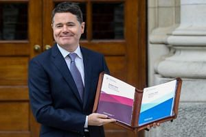 Irish Finance Minister Paschal Donohoe presents Budget 2020 at Government Buildings in Dublin on Oct 8, 2019.