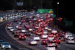 Motor vehicles drive on the 101 freeway in Los Angeles, California. From Los Angeles to Tokyo, 34 cities committed on Oct 11, 2019, to meet WHO minimum air quality levels by 2030.