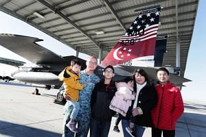 Military Expert 2 Lee Ban Chin and his wife Angelia Giam have lived on the Mountain Home Air Force Base in Idaho for the past two years. They have four children: (from right) Clemens, 14, Fayth, three, Damir, 12, and Eytan, five.