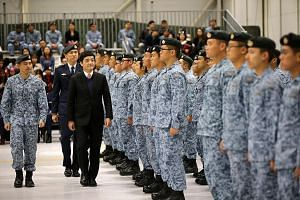 Senior Minister of State for Defence Mr Heng Chee How inspecting the Peace Carvin V parade at Mountain Home Air Force Base in Idaho on Thursday. Behind Mr Heng is Brigadier-General Ho Kum Luen, commander of the RSAF's Air Combat Command.