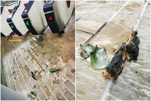 Damage is seen inside Kowloon Tong MTR station after protesters threw petrol bombs inside, on Oct 12, 2019.