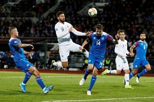 France's Olivier Giroud heads at goal during the Euro 2020 Qualifier - Group H - Iceland v France match at the Laugardalsvollur Stadium in Reykjavik, Iceland on Oct 11, 2019.